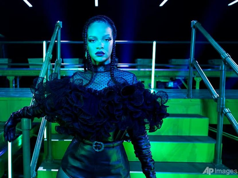 Rihanna wants to cheer up a troubled world with a fashion show