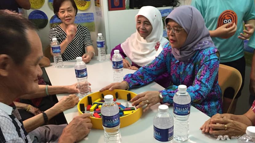 President Halimah Yacob plays board games with elderly to promote intergenerational bonding