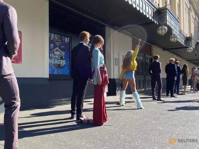 Waxworks of Queen Elizabeth, Donald Trump and Taylor Swift form a social distanced queue outside Madame Tussauds