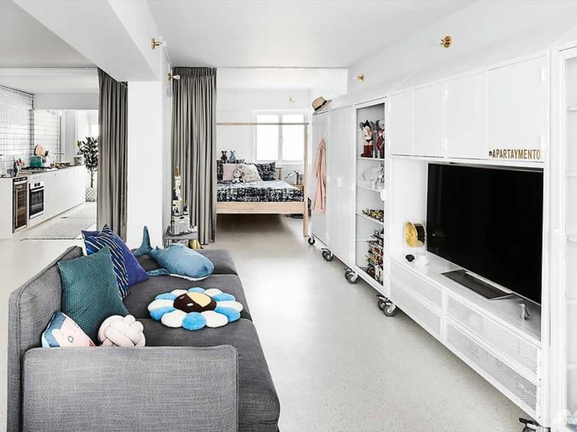 How a 732 sq ft open-plan HDB home uses mobile furniture for a new layout every time