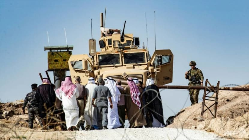 Syrian Kurds defend key town as Pence, Pompeo sent to press Turkey