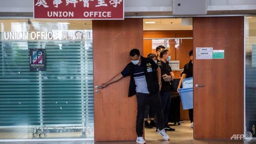Hong Kong police raid top university in security law probe