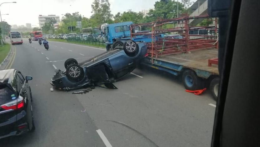 Car driver taken to hospital after accident involving bus, trailer