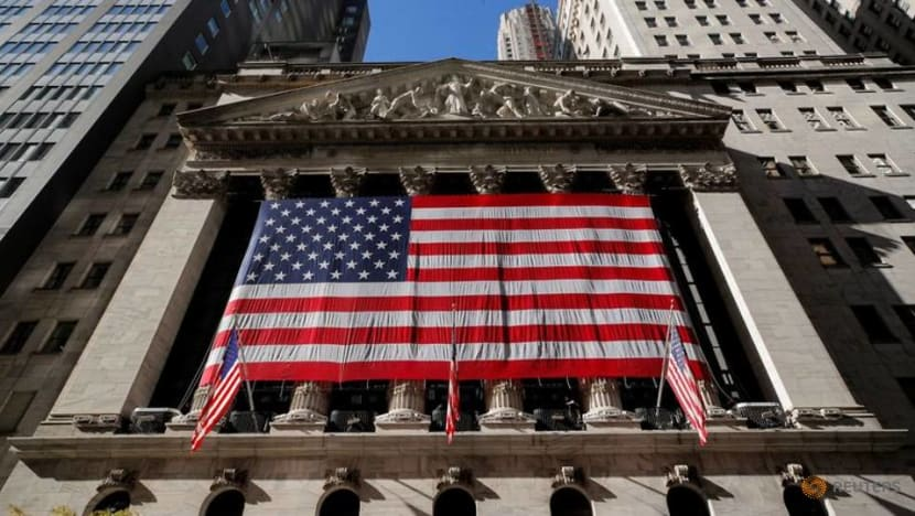 Wall Street hits record highs as vaccine trial results raise hopes