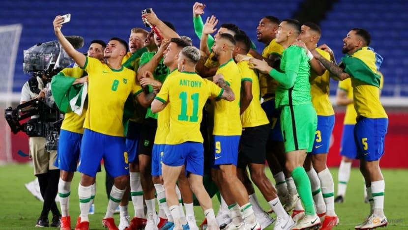 Olympics-Soccer-Malcom grabs golden glory for Brazil