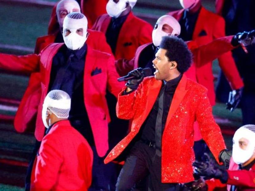 Pop singer The Weeknd brings bright lights, bandaged dancers to Super Bowl