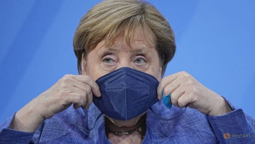 Merkel says COVID-19 curbs to stay until more Germans get shots