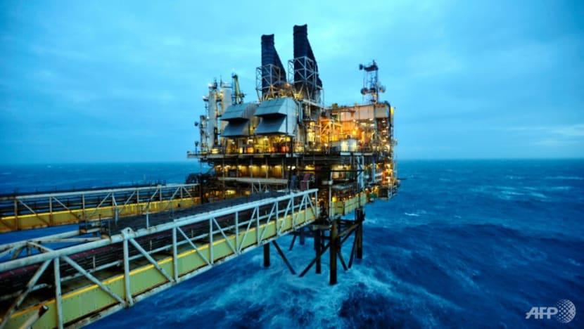 Oil prices slide on shattered demand, European stocks rise