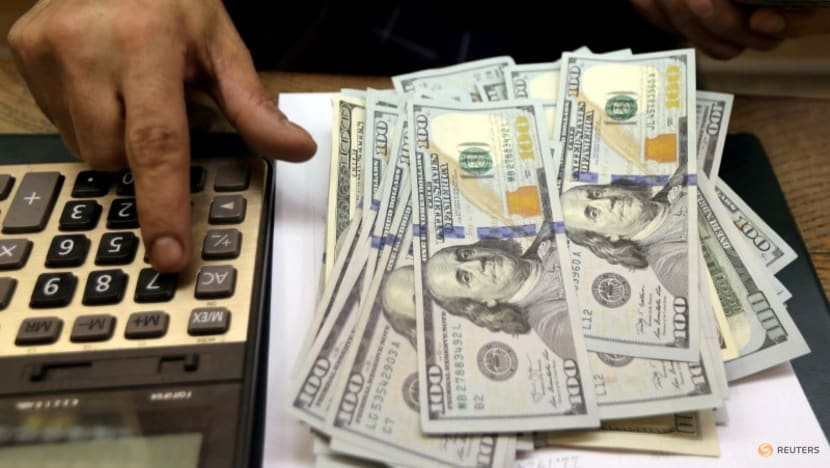 Dollar languishes near one-week low after consumer sentiment blow