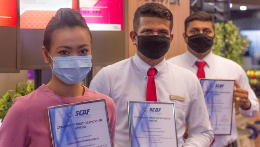 Scoot stewardess, security officers get SCDF award for saving cleaner's life at Yew Tee Point