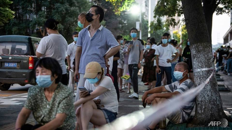 China restricts overseas travel to curb COVID-19 outbreak