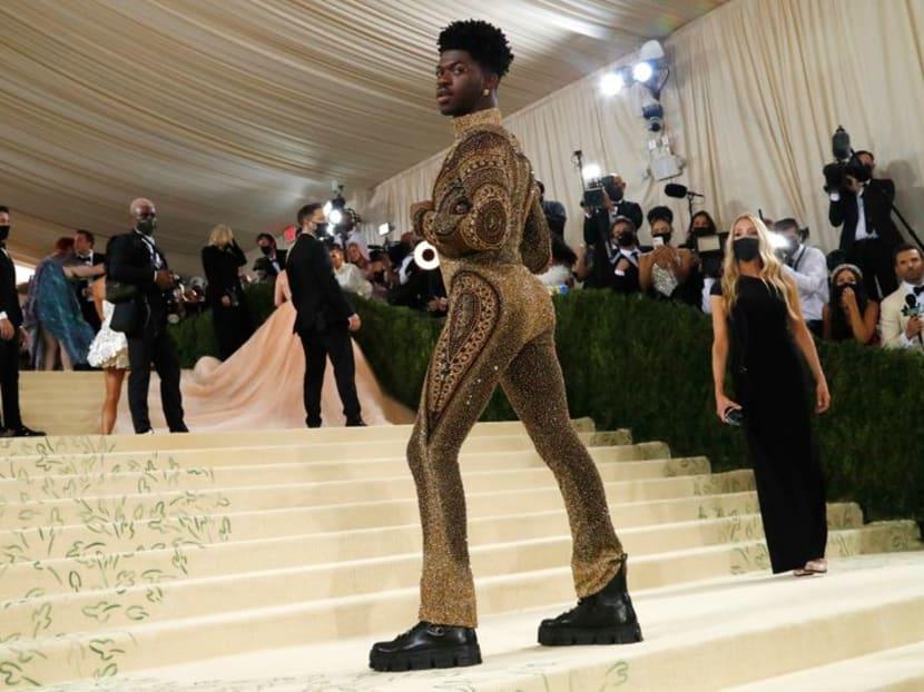 Gold armor for Lil Nas X, all black for Kim Kardashian at Met Gala