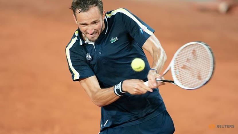 Tennis-Medvedev overcomes slow start to reach French Open third round