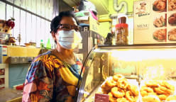 A 'miracle' once saved these hawkers' lives. Their stall is now battling to survive again