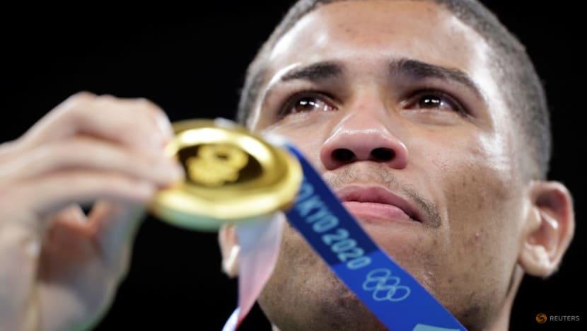 US takes 16th Olympic men's basketball gold, rain threatens baseball