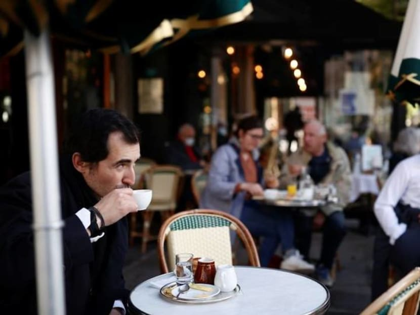 Parisians tuck into coffee and croissants again as cafes re-open