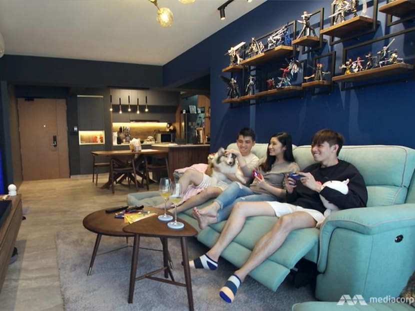 A geeky couple's 1,001 sq ft BTO flat with a gaming room and toys on display