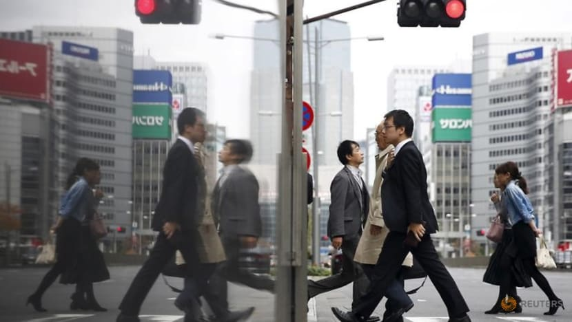 Japan proceeds with twice-delayed sales tax hike as growth sputters