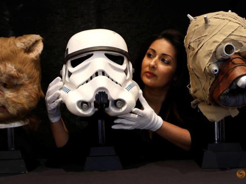 Star Wars stormtrooper helmet, Jurassic Park dinosaur skulls up for auction