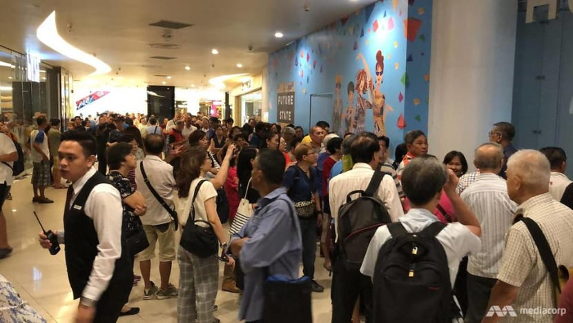 Anger, frustration as long queues form across Singapore for S$54 Huawei phone