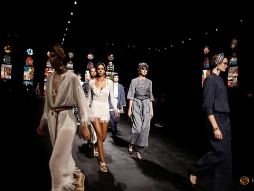 With masked guests, Dior returns to catwalk in Paris