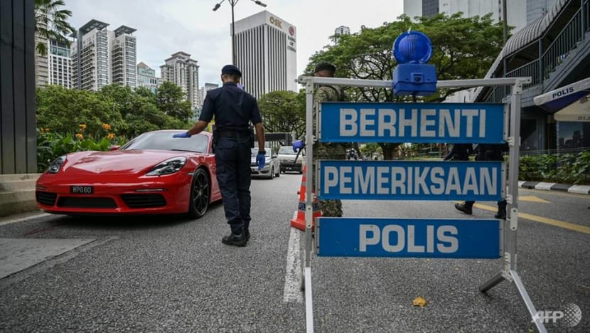 Malaysia reports 2,985 new COVID-19 cases as renewed movement curbs take effect