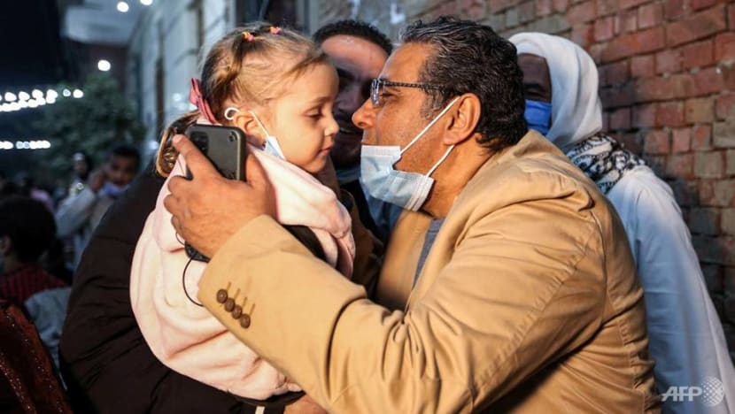Freed Egyptian Al Jazeera journalist returns home after 4 years in prison