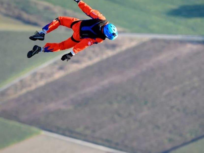 Parachutist makes world's first jump from solar-powered plane
