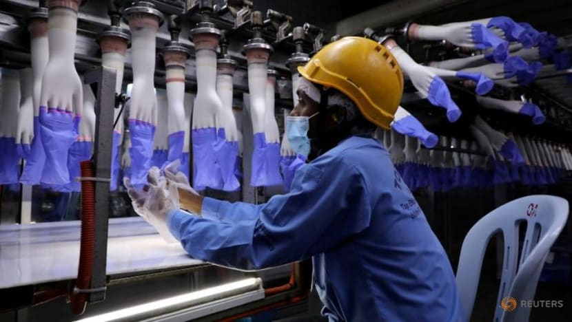 Malaysia's Top Glove workers put under tighter COVID-19 restrictions