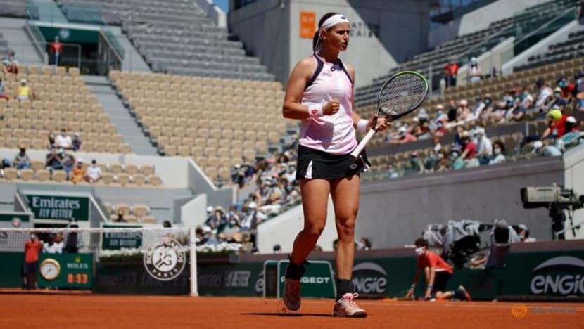 Tennis-Kvitova saves matchpoint to reach second round