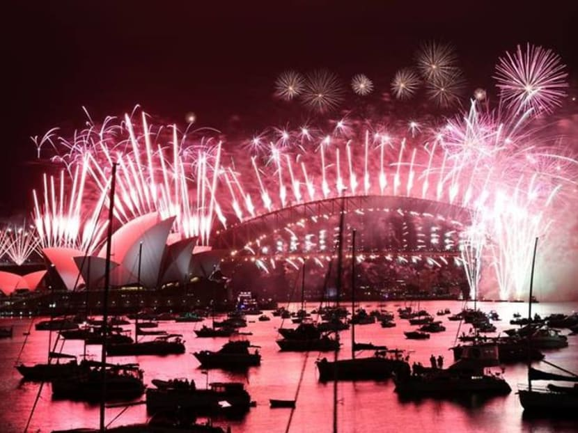 Fireworks explode over deserted streets as 2020 slinks off into history