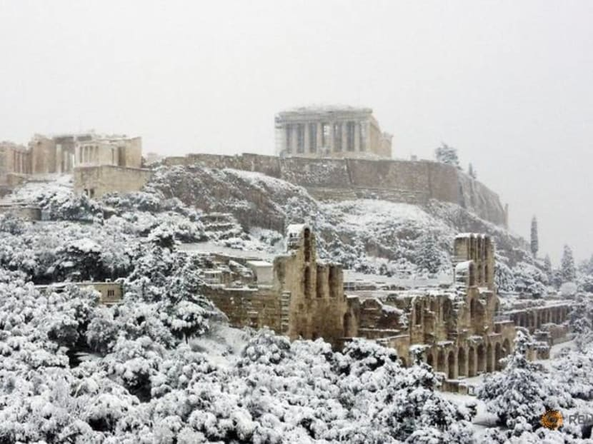 Acropolis covered by rare snow as cold snap hits Athens