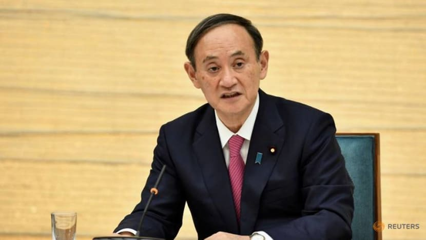 Spokeswoman for Japan PM Suga resigns over expensive dinners with his son