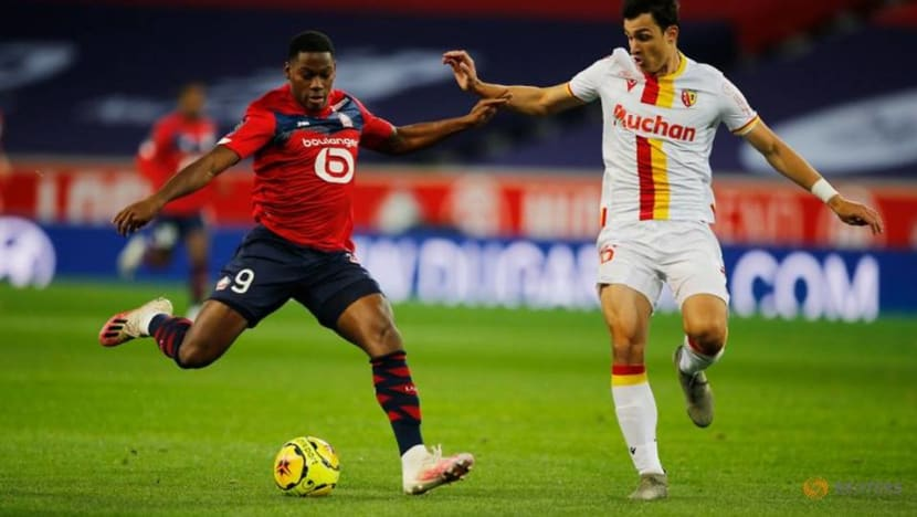 Football: Lille go top as Lens see red in northern derby