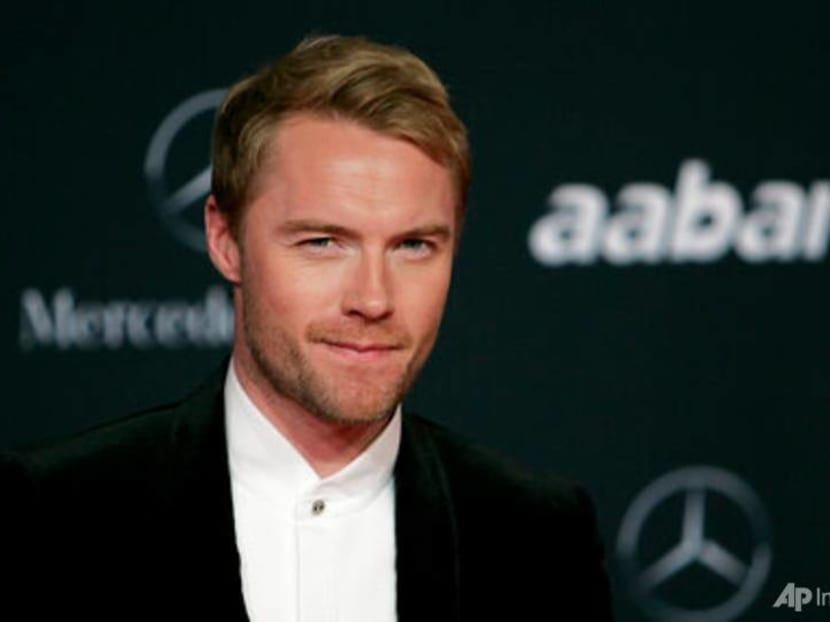 Singer Ronan Keating accepts damages in tabloid phone hacking case
