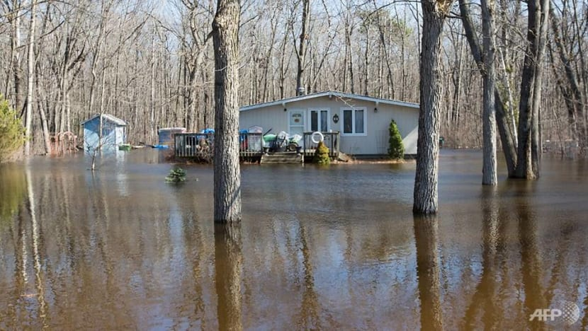 Dike breached, thousands evacuated near Montreal as floods worsen
