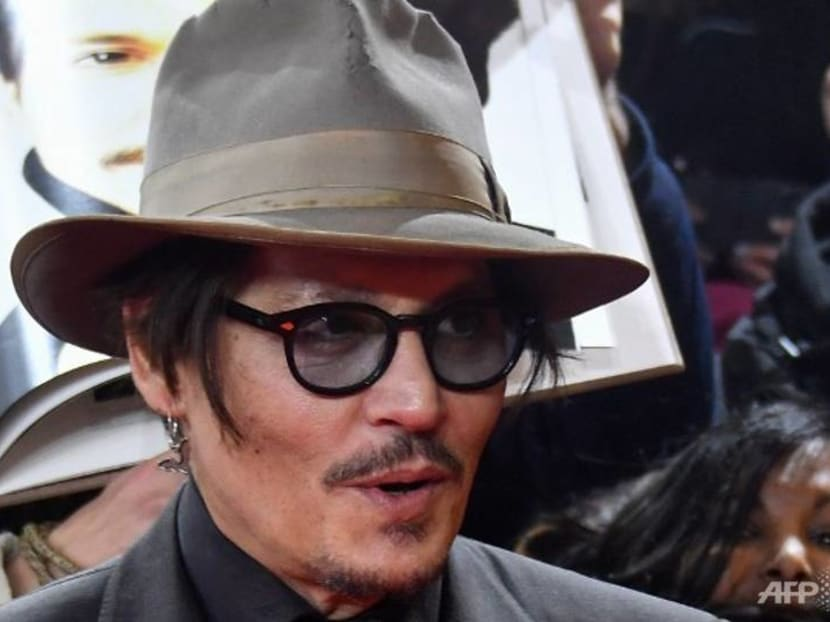 Actor Johnny Depp takes on UK tabloid in court battle over 'wife beater' claims
