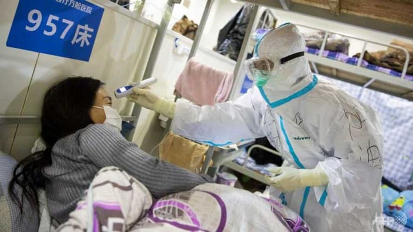 China sees fall in COVID-19 deaths as WHO urges caution