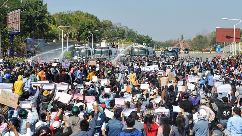 Dozens arrested as Myanmar protesters defy military warnings; water cannon fired for a second day
