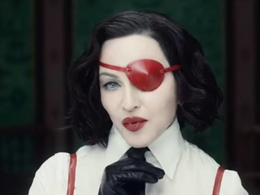 Madonna is an eye-patched seductress in raunchy cha-cha video Medellin