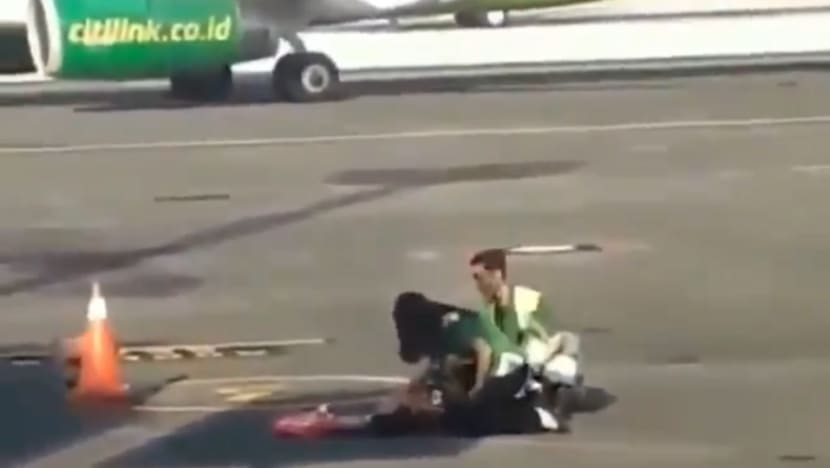 Woman chases after plane on tarmac at Bali airport after missing her flight