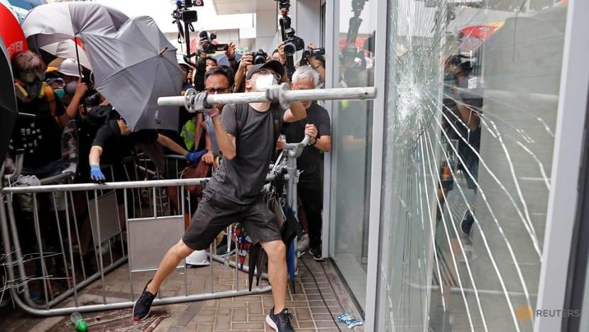 Protesters try to smash way into Hong Kong Legislative Council