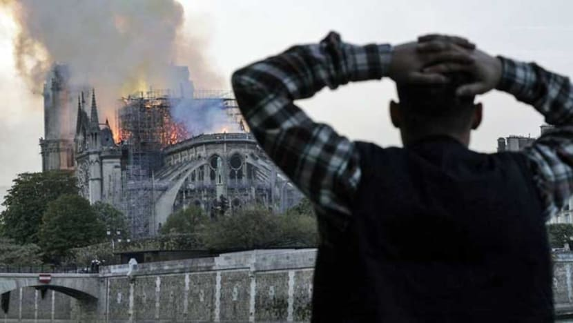 'Paris is disfigured': Tears and shock as Notre-Dame burns