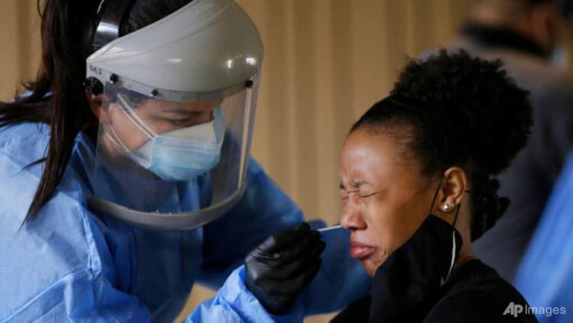 US sets record for COVID-19 cases amid election battle over virus