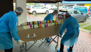 Funeral services in Singapore prepare for more COVID-19 deaths, adapt to special requests