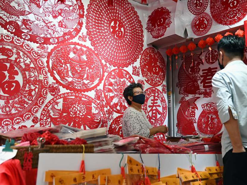 A COVID-19 Chinese New Year: Simple celebrations and safety measures at restaurants, shops