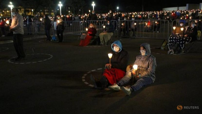 Thousands pray in Portugal's main Catholic site for end to COVID-19 pandemic