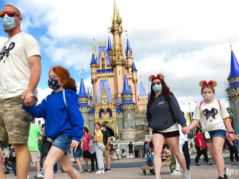 Mickey's flashy dress, glowing castle mark Disney World 50th