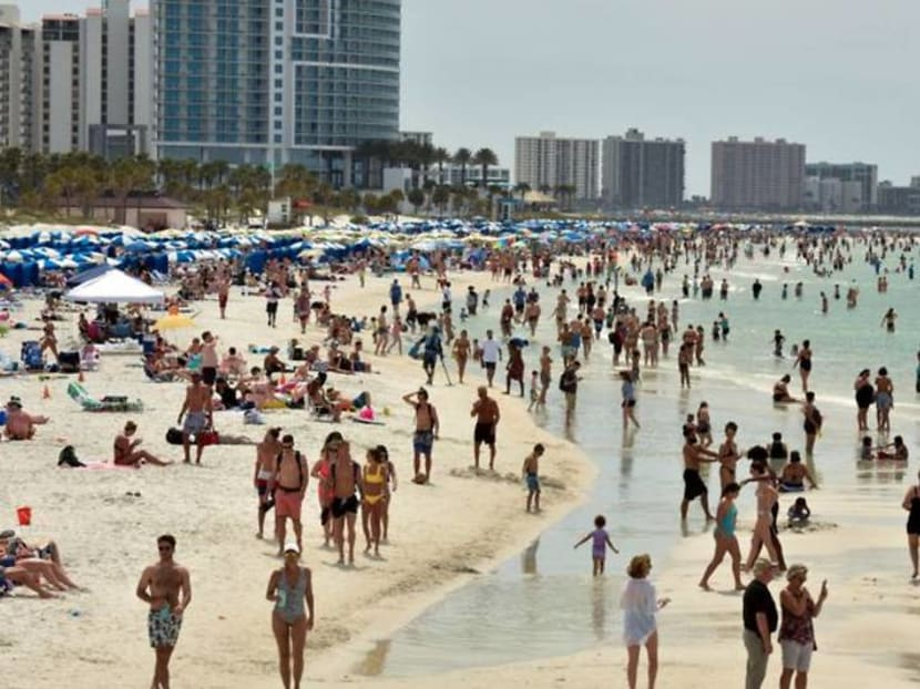 From Florida to 'Frisco', Americans flock to movies, bars and ballparks after winter of worry