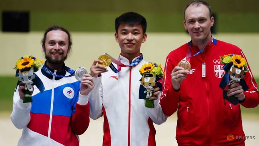 Olympics-Shooting-Zhang sets rifle 3P world record, Quiquampoix wins rapid gold